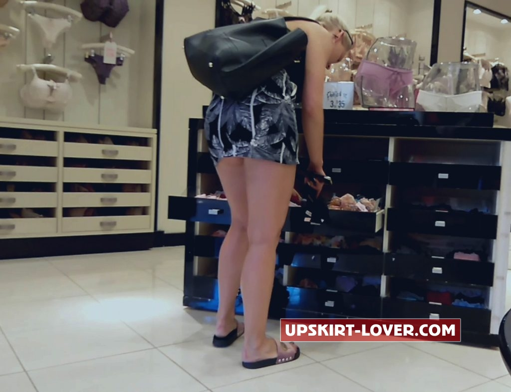 Sexy blonde photographed by voyeur in store